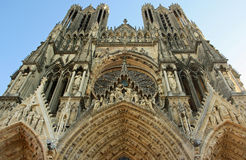 Gothic Notre-Dame Cathedral in Reims (France). The facade of the gothic Our Lady (Notre-Dame) cathedral in Reims (France). The UNESCO World Heritage site Royalty Free Stock Photography