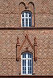 Gothic Ornamentation. Two practical windows are made more interesting by Gothic ornamentation  and brickwork Royalty Free Stock Photo