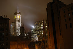 Gothic Philadelphia. A foggy moonlit portrait of the city of Philadelphia's Skyline .  City Hall is framed by shadowed highrise's and the william penn statue is Royalty Free Stock Image