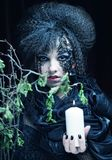 Gothic portrait of woman with candle. Halloween theme royalty free stock photography