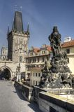 Gothic Prague. Pragues gothic tower and sculpture on the Charles bridge in the historical centre of Prague, Czech Royalty Free Stock Photography