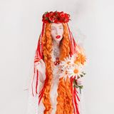 Gothic redhead woman vampire in flower wreath with pale skin and red lips. Vampire with burn fire bouquet. Gothic witch in wreath royalty free stock photos