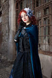 Gothic redhead woman walking. Gothic redhead woman in medieval dress stock images