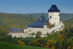 Gothic royal castle Karlstejn in green forest window during autumn, Central Bohemia, Czech republic, Europe Stock Images