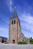 Gothic Saint-Servatius church in Ravels, Belgium. Against a blue sky with dramatic clouds Stock Photo