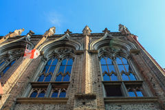 Gothic school in Tbilisi bottom view. Windows of gothic school in Tbilisi with georgian flag, bottom view royalty free stock photos