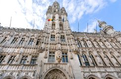 Gothic sculptures and tower of the 15th century Town Hall, UNESCO World Heritage Site in Brussels. BRUSSELS, BELGIUM - APR 3: Gothic sculptures and tower of the royalty free stock image