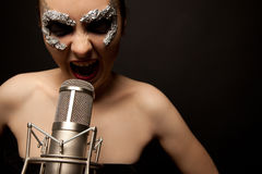 Gothic singer standing with microphone Royalty Free Stock Photos