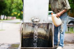 Gothic spigot installed on a flowing artesian wellhead. Selective focus. Royalty Free Stock Photo