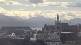 Gothic spire of Saint Francois Church, misty cityscape of Lausanne, Switzerland. Stock footage stock video footage