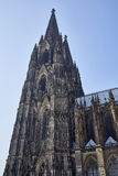 The gothic spires of Cologne Cathedral reaching towards the sky. View upwards along a portion of Cologne Cathedral, Germany royalty free stock photo