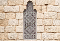 Gothic Stained Glass. Horizontal view of a gothic stained glass window and a granite block wall. Belongs to the Bishop's Palace. Located in Astorga, Spain Stock Photos