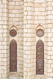 Gothic Stained Glass. Exterior view of two gothic stained glass. With granite blocks wall and columns. Belongs to the Bishop's Palace. Located in Astorga, Spain Royalty Free Stock Image