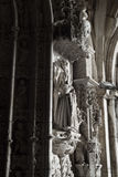 Gothic statue at main gate of a church Stock Photos