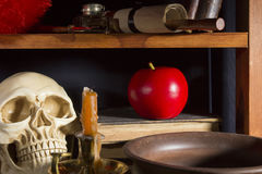 Gothic still life. With a skull and an apple Royalty Free Stock Image