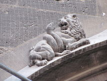 Gothic stone carving of lion and snake. Gothic stone carving of a lion fighting a snake. Munich, Germany Stock Images