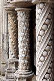 Gothic stone patterned columns architecture. Columns supporting intricate arcade screens. They are decorated with spiral motives, armillaries, lotus blossoms Royalty Free Stock Photos