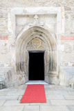 Gothic style cathedral entrance. The entrance of an old gothic style cathedral. Frontal view. Red carpet announced a wedding ceremony Royalty Free Stock Photos