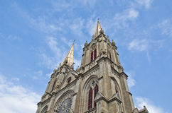 Gothic style Catholic church tower. Stock Photos