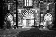 Gothic style entrance portal of Basilica of Saint Peter and Paul in Vysehrad, Prague, Czech Republic. Black and white image Stock Photography