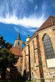 The gothic style Nikolaikirche Saint Nicholas church in the historical center of Jueterbog, Brandenburg, Germany. In a sunny summer day with blue sky Stock Photo