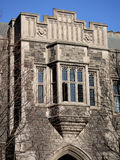 Gothic style school building. A neogothic style oriel window on a college building stock photo