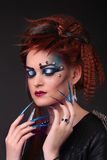 Gothic style shot of a woman with claw rings with eyes closed Royalty Free Stock Photos