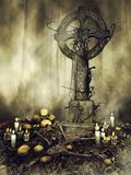 Gothic tombstone with skulls and candles Royalty Free Stock Photo