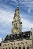 The Gothic town hall and its Belfry tower in the French city Arras on a blue sky with white clouds background, World Heritage by U. NESCO. Travel, Europe stock image