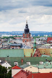 Gothic town hall tower with clock in Cracow, Poland. Aerial view Stock Photos