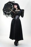 Gothic vampire girl in black dress with umbrella. Gothic vampire girl in black dress with black umbrella Stock Image