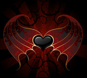 Gothic vampire heart. Gothic black heart of a vampire with skin, membranous wings, the dark luminous background Stock Photo