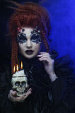 Gothic vampire woman with skull Stock Photos