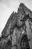 Gothic Vysehrad cathedral in Prague with beautiful stone statues in black and white Royalty Free Stock Image