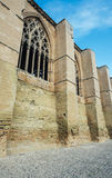 Gothic window with details of a castle and part of the wall. Royalty Free Stock Photos
