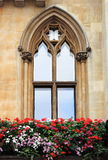 Gothic window with flowers Royalty Free Stock Photos