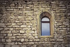 Gothic window on old castle wall. Textural image of historic building stock photography