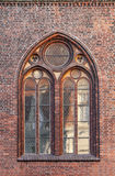 Gothic window in red brick wall Stock Photos