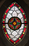 Gothic window from stained glass. Gothics ornamental stained glass window in a medieval church stock photography