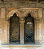 Gothic windows. Of the cloister of Lagrasse's Abbey royalty free stock photo