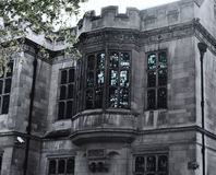 Gothic Windows of the old grey Mansion, the Bulldog, London, near Temple Stock Images