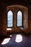 Gothic windows in the Palatial Residence (Pacos Novos) of the Leiria Caste. Royalty Free Stock Photo