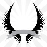 Gothic Wings Crest. Gothic looking angel wings crest with a banner ribbon isolated over a silver rays background Stock Photos