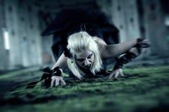 Gothic woman. Creep on the floor Royalty Free Stock Photos