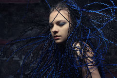 Gothic woman with blue  dreadlocks. Royalty Free Stock Photo