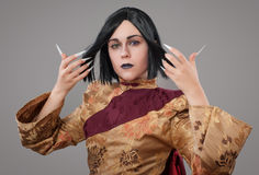 Gothic woman with chinese nails Royalty Free Stock Images