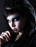 Gothic woman with cross. Portrait of young gothic woman with cross on chain in her hand Royalty Free Stock Photography