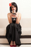 Gothic woman with a glass of wine Royalty Free Stock Images