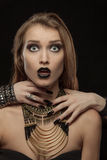 Gothic woman with hands of vampire on her neck Stock Images