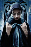 Gothic woman with head scarf stock image